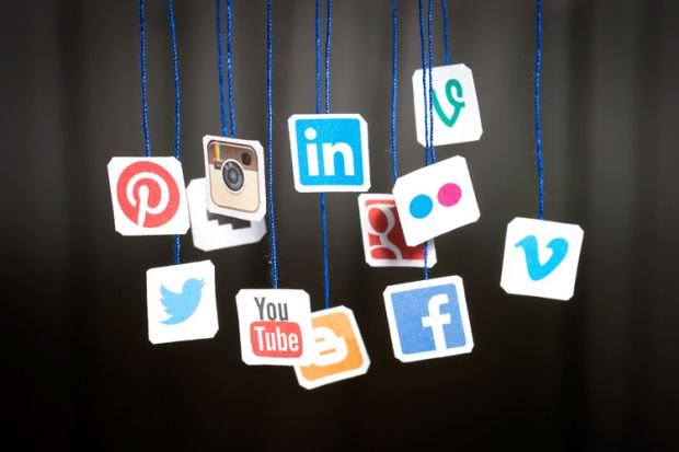 social-media-icons-hanging-from-blue-string